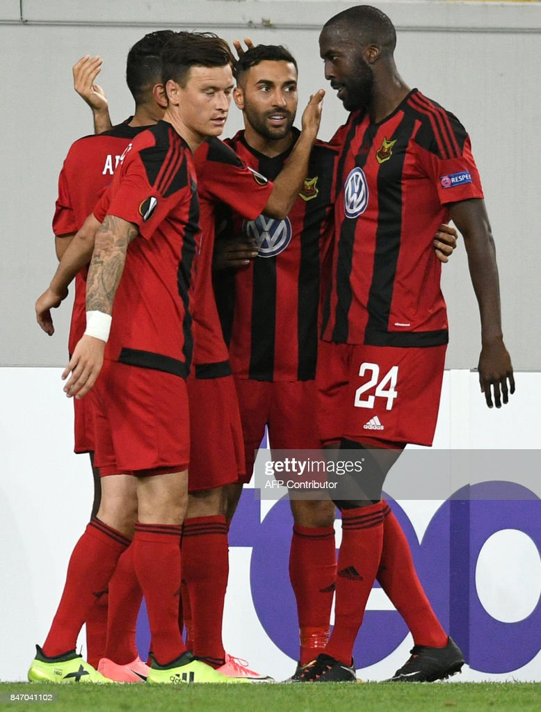 Ostersund's forward Saman Ghoddos celebrates with teammates after scoring during the UEFA Europa League Group J football match between Zorya Lugansk and Ostersunds FK in Lviv on September 14, 2017. / AFP PHOTO / Genya SAVILOV