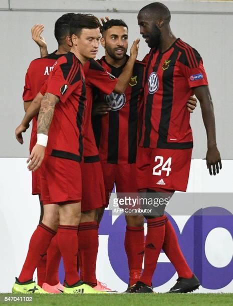 Ostersund's forward Saman Ghoddos celebrates with teammates after scoring during the UEFA Europa League Group J football match between Zorya Lugansk...