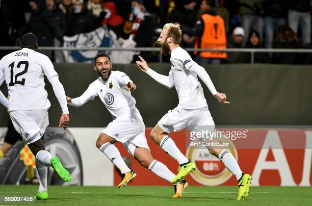 Ostersunds' midfielder from England Curtis Edwards celebrates scoring the 21 with his teammates during the UEFA Europa League group F fotball match...