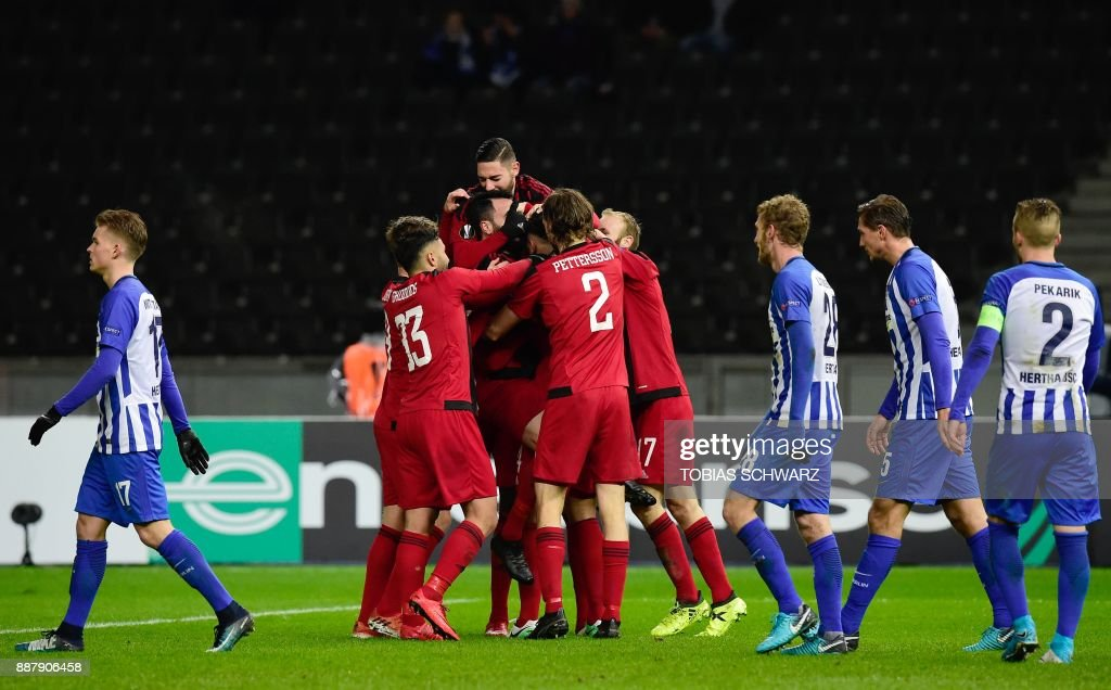 Ostersund's players (C) celebrate after socring the 0-1 during the UEFA Europa League group J football match Hertha BSC Berlin vs Ostersund FK on December 7, 2017 in Berlin. PHOTO / Tobias SCHWARZ