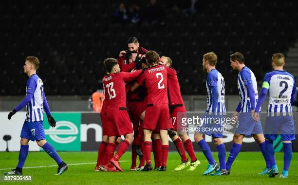 Ostersund's players celebrate after socring the 01 during the UEFA Europa League group J football match Hertha BSC Berlin vs Ostersund FK on December...