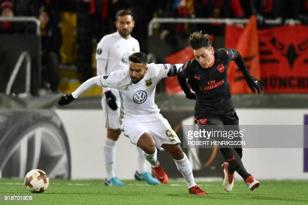 Ostersund's Saman Ghoddos vies for the ball with Arsenal's Mesut Özil during the UEFA Europa League round of 32 first leg football match of Ostersund...