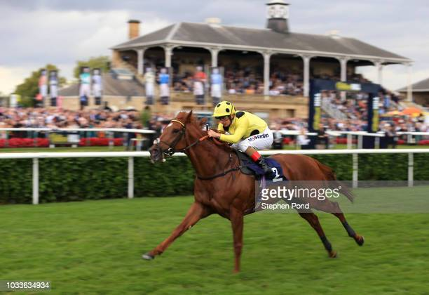 Ostilio ridden by jockey Andrea Atzeni wins the PJ Tower Construction Ltd Handicap Stakes at Doncaster Racecourse on September 15 2018 in Doncaster...