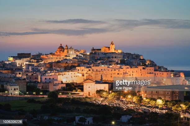 ostuni, italy at dusk - ostuni stock photos and pictures