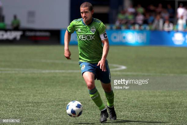 Osvaldo Alonso of Seattle Sounders dribbles with the ball in the second half against the Columbus Crew during their game at CenturyLink Field on May...