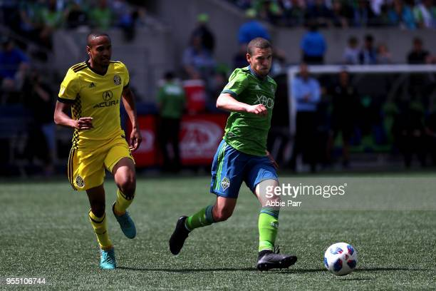 Osvaldo Alonso of Seattle Sounders dribbles with the ball in the second half against Ricardo Clark of Columbus Crew during their game at CenturyLink...