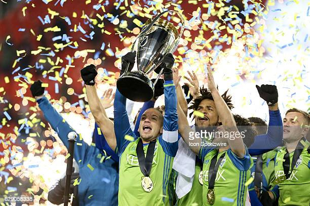 Osvaldo Alonso of Seattle Sounders lifts the MLS Cup after defeating Toronto FC 54 in penalty kicks of the MLS Cup Final on December 10 at BMO Field...