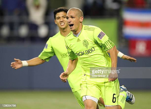 Osvaldo Alonso of the Seattle Sounders FC celebrates with Fredy Montero after scoring the second goal against the Chicago Fire during the 2011 Lamar...