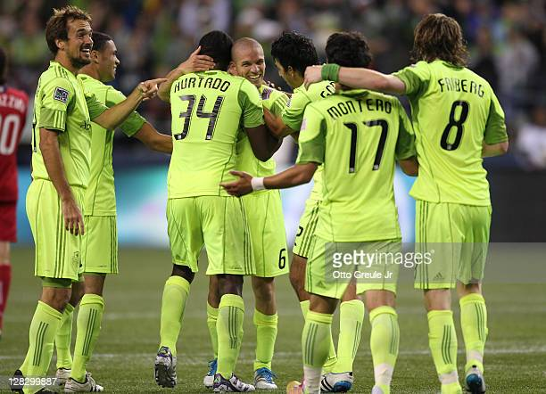 Osvaldo Alonso of the Seattle Sounders FC celebrates with teammates after scoring the second goal against the Chicago Fire during the 2011 Lamar Hunt...