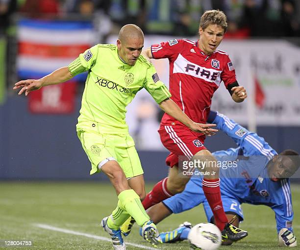 Osvaldo Alonso of the Seattle Sounders FC scores the second goal against goalkeeper Sean Johnson of the Chicago Fire during the 2011 Lamar Hunt US...