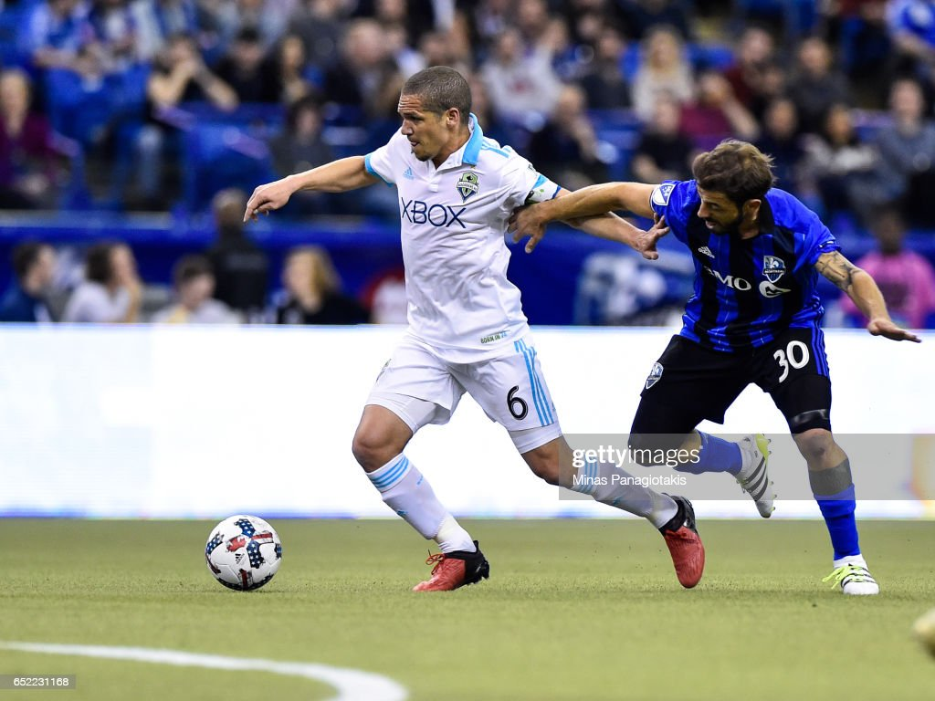 Osvaldo Alonso #6 of the Seattle Sounders tries to get the ball past Hernan Bernardello #30 of the Montreal Impact during the MLS game at Olympic Stadium on March 11, 2017 in Montreal, Quebec, Canada.