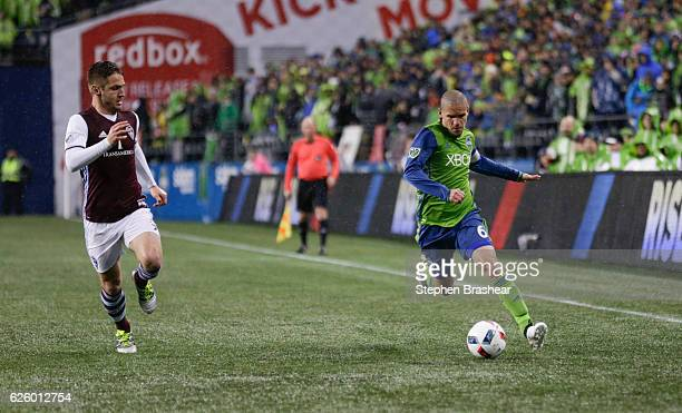Osvaldo Alonso right dribbles the ball down the pitch as Kevin Doyle of the Colorado Rapids defends during a match in the first leg of the Western...
