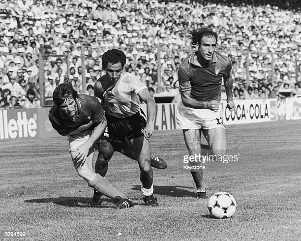 Osvaldo Ardiles of Argentina between two Italian footballers Gabriele Oriali and Francesco Graziani during a game in the World Cup