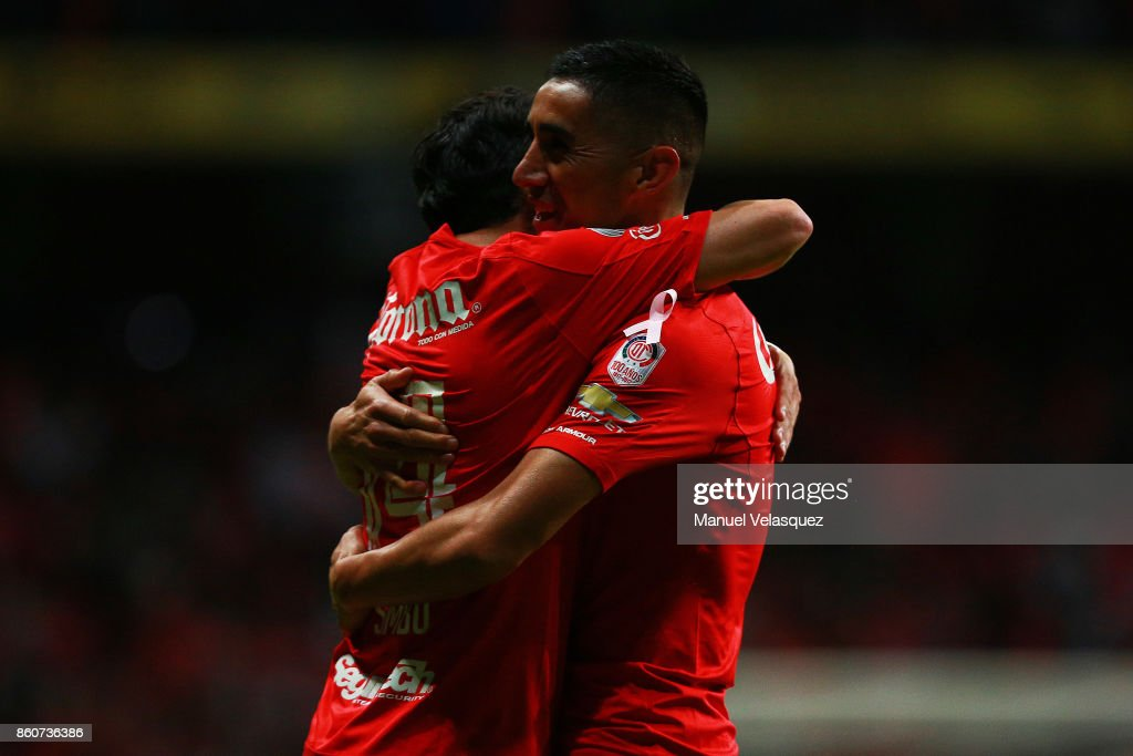 Osvaldo Gonzalez of Toluca celebrates with his teammate Rubens Sambueza after scoring the second goal of his team during the 13th round match between Toluca and Lobos BUAP as part of the Torneo Apertura 2017 Liga MX at Nemesio Diez Stadium on October 11, 2017 in Toluca, Mexico.