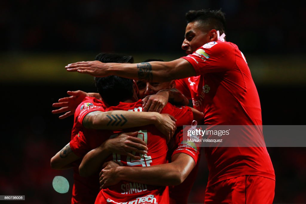 Osvaldo Gonzalez of Toluca celebrates with teammates after scoring the second goal of his team during the 13th round match between Toluca and Lobos BUAP as part of the Torneo Apertura 2017 Liga MX at Nemesio Diez Stadium on October 11, 2017 in Toluca, Mexico.