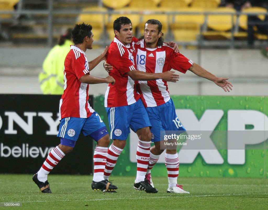 Osvaldo Martinez, Nelson Haedo and Carlos Bonet of Paraguay celebrate a goal during the International Friendly match between the New Zealand All Whites and Paraguay at Westpac Stadium on October 12, 2010 in Wellington, New Zealand.