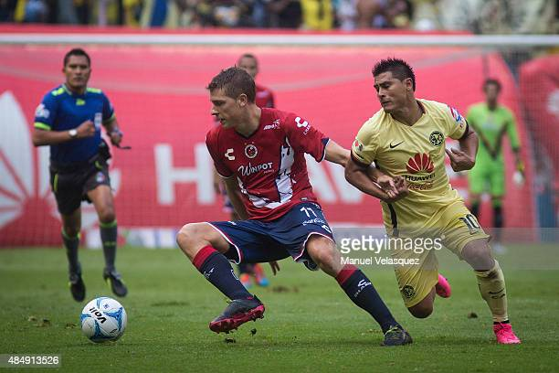 Osvaldo Martinez of America struggles for the ball with Julio Furch of Veracruz during a 6th round match between America and Veracruz as part of...