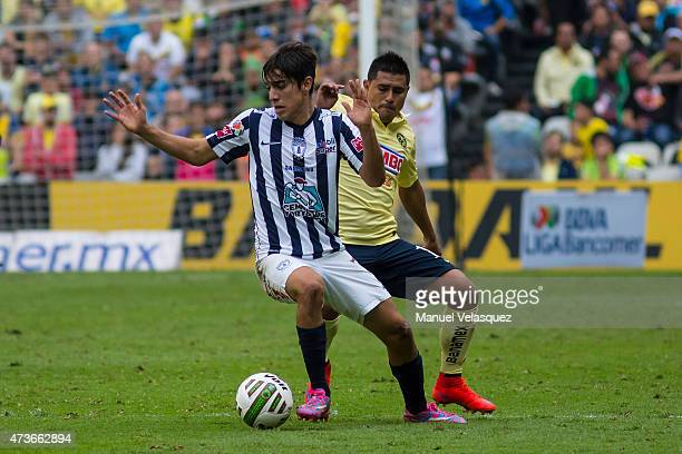 Osvaldo Martinez of America struggles for the ball with Rodolfo Pizarro during a quarterfinal second leg match between America and Pachuca as part of...