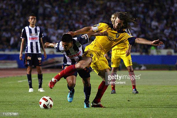 Osvaldo Martinez of Monterrey fights for the ball with Kyle Beckerman for Real Salt Lake during the first leg as part of the Champions League...