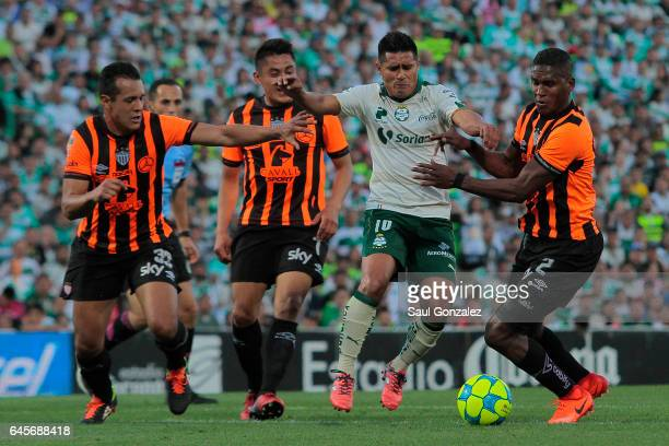 Osvaldo Martinez of Santos and Brayan Beckeles of Necaxa fight for the ball during the 8th round match between Santos Laguna and Necaxa as part of...
