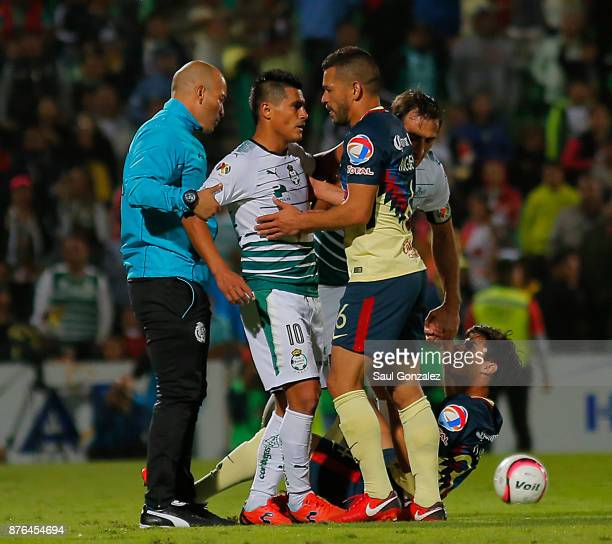 Osvaldo Martinez of Santos argues with Miguel Samudio of America during the 17th round match between Santos Laguna and America as part of the Torneo...