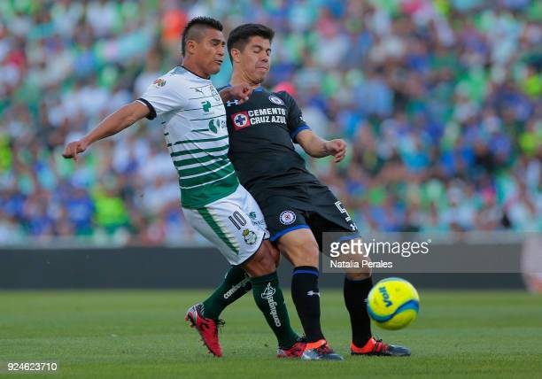 Osvaldo Martinez of Santos fights for the ball with Francisco Silva of Cruz Azul during the 9th round match between Santos Laguna and Cruz Azul as...