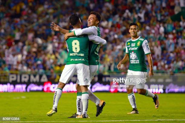 Osvaldo Rodriguez of Leon celebrates with teammates after scoring the second goal of his team during the 3rd round match between Leon and Cruz Azul...