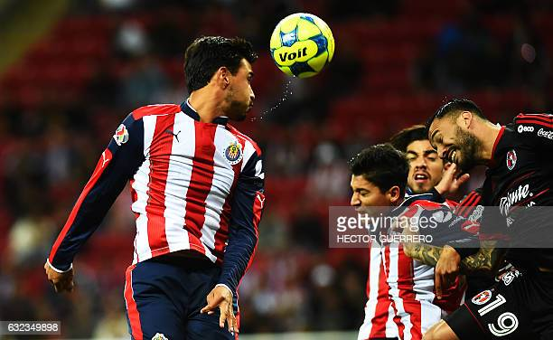 Oswaldo Alanis and Angel Zaldivar of Guadalajara vie for the ball with Emanuel Aguilera of Tijuana during their Mexican Clausura 2017 tournament...