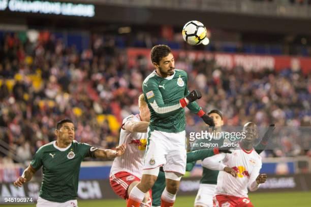 Oswaldo Alanis of C.D. Guadalajara heads clear during the New York Red Bulls Vs C.D. Guadalajara CONCACAF Champions League Semi-final 2nd leg match...