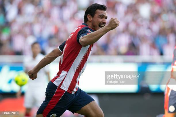 Oswaldo Alanis of Chivas celebrates after a goal scored by his teammate Nestor Calderon during the semi final second leg match between Chivas and...