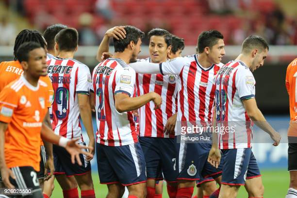 Oswaldo Alanis of Chivas celebrates with his teammates after scoring the first goal of his team during the match between Chivas and Cibao as part of...