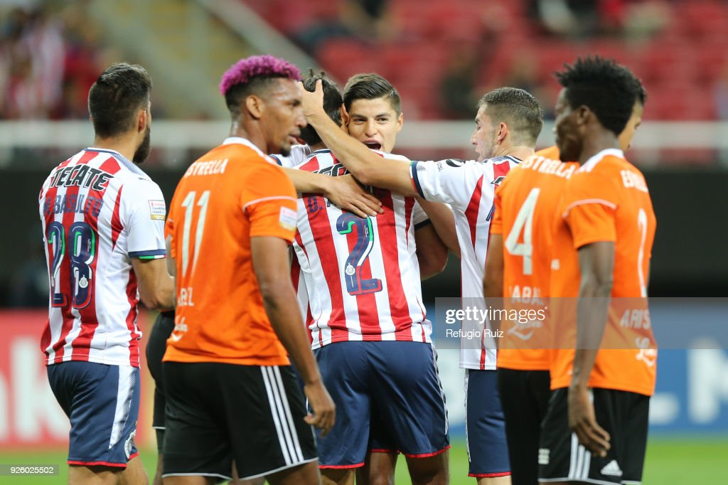 Oswaldo Alanis of Chivas celebrates with his teammates after scoring the first goal of his team during the match between Chivas and Cibao as part of the round of 16th of the CONCACAF Champions League at Akron Stadium on February 28, 2018 in Zapopan, Mexico.