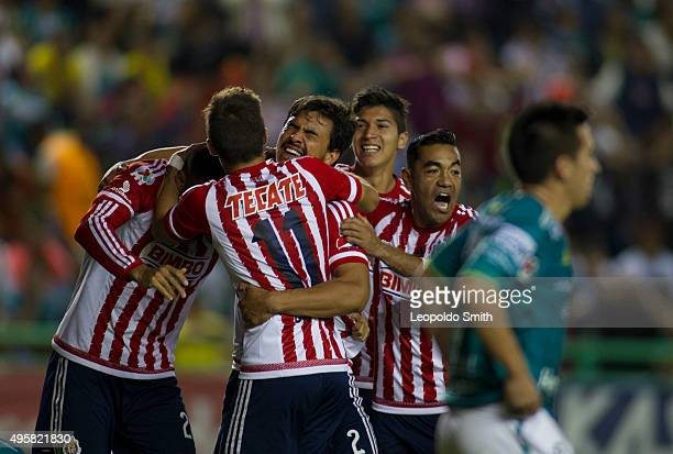 Oswaldo Alanis of Chivas celebrates with teammates after scoring the opening goal during the Final match between Leon and Chivas as part of the Copa...