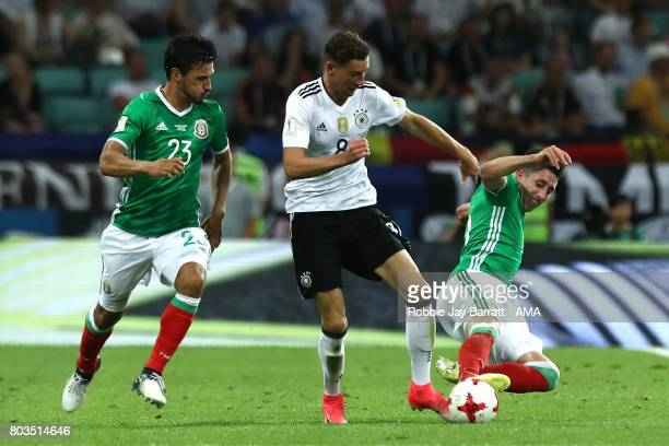 Oswaldo Alanis of Mexico and Hector Herrera of Mexico compete with Leon Goretzka of Germany during the FIFA Confederations Cup Russia 2017 SemiFinal...