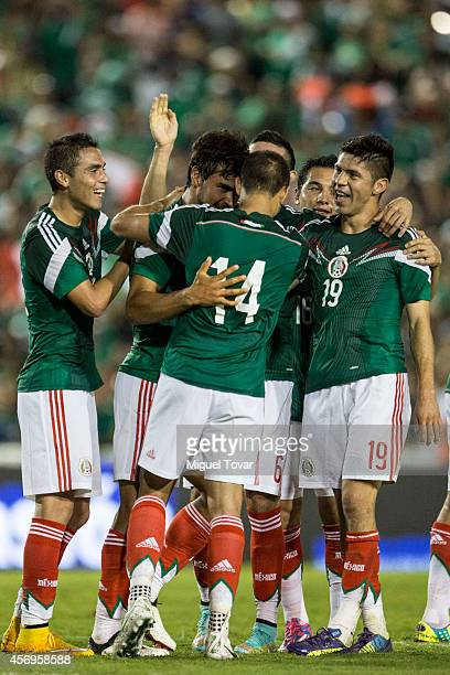 Oswaldo Alanis of Mexico celebrates with teammates after scoring during a friendly match between Mexico and Honduras at Victor Manuel Reyna Stadium...