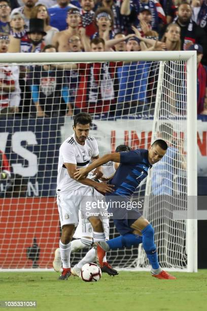 Oswaldo Alanis of Mexico fights for the ball during an international friendly match between Mexico and United States at Nissan Stadium on September...