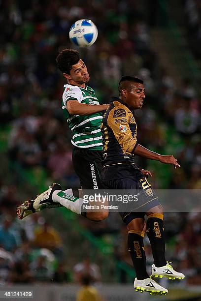 Oswaldo Alanis of Santos and Daniel Emanuel Ludueña fight for the ball during a match between Santos Laguna and Pumas UNAM as part of the 13th round...