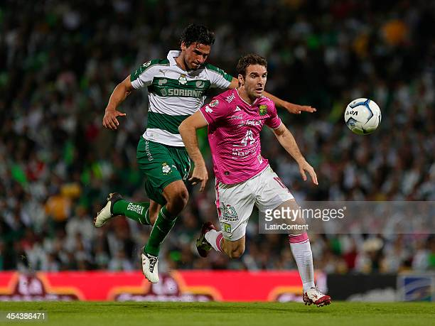 Oswaldo Alanis of Santos and Mauro Boselli of Leon fight for the ball during the leg 2 of a Semifinal match between Santos Laguna and Leon as part of...