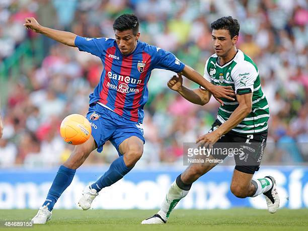 Oswaldo Alanis of Santos struggles for the ball during a match between Santos Laguna and Atlante as part of the 15th round Clausura 2014 Liga MX at...