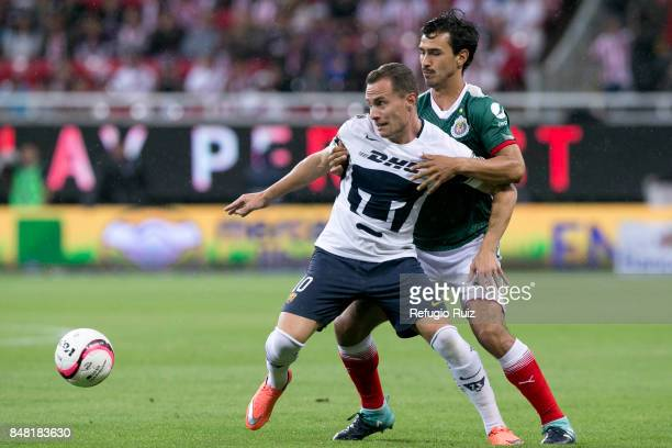 Oswaldo Alanís of Chivas fights for the ball with Abraham Gonzalez of Pumas during the 9th round match between Chivas and Pumas UNAM as part of the...