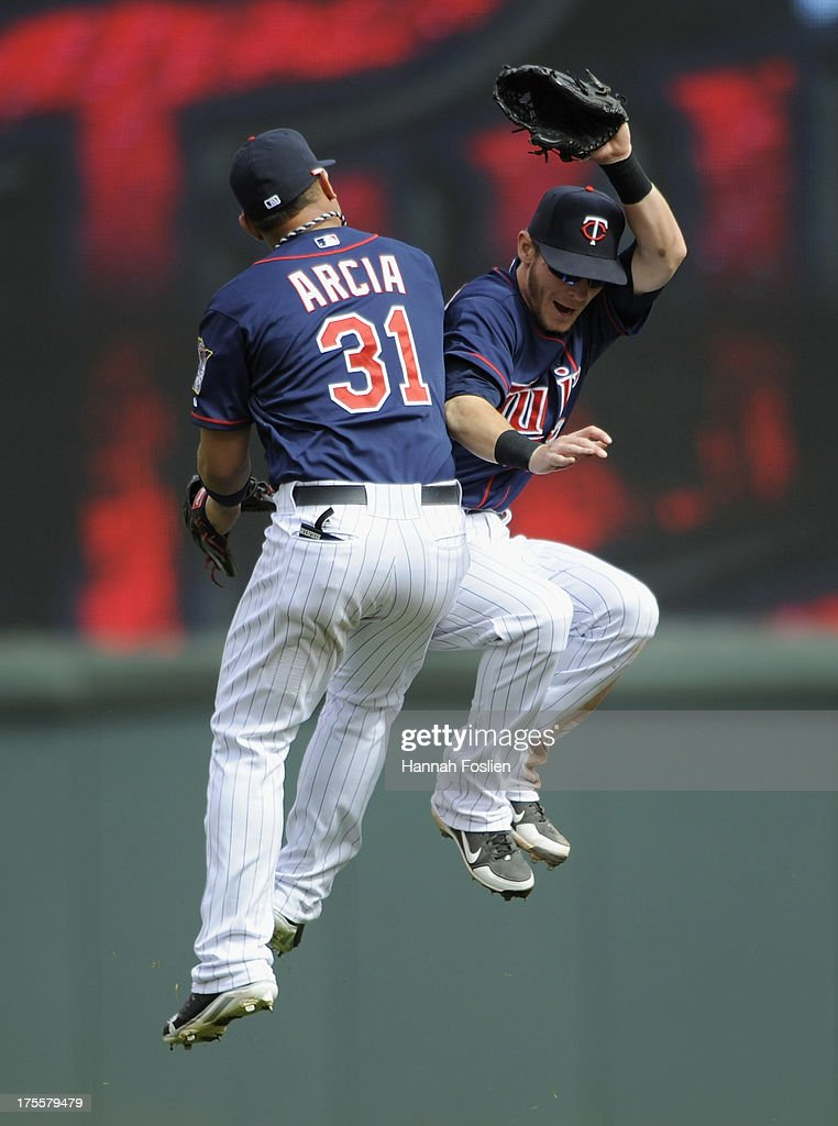 Oswaldo Arcia #31 and Chris Herrmann #12 of the Minnesota Twins celebrate a win of the game against the Houston Astros on August 4, 2013 at Target Field in Minneapolis, Minnesota. The Twins defeated the Astros 3-2.