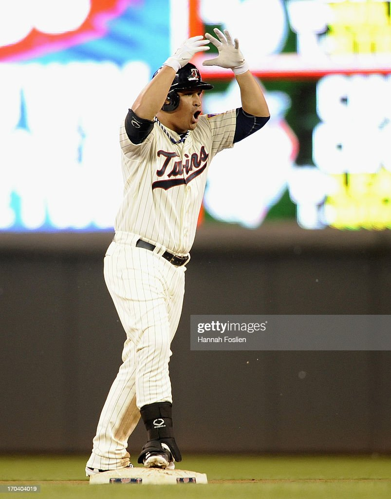 Oswaldo Arcia #31 of the Minnesota Twins celebrates a lead-off double against the Philadelphia Phillies during the eighth inning of the game on June 12, 2013 at Target Field in Minneapolis, Minnesota. The Twins defeated the Phillies 4-3.