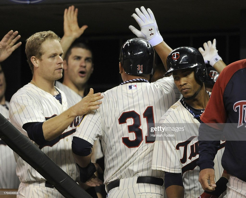 Oswaldo Arcia #31 of the Minnesota Twins celebrates scoring the tying run against the Philadelphia Phillies during the eighth inning of the game on June 12, 2013 at Target Field in Minneapolis, Minnesota. The Twins defeated the Phillies 4-3.