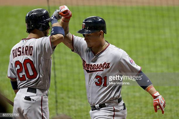 Oswaldo Arcia of the Minnesota Twins celebrates with Eddie Rosario after hitting a two run homer in the sixth inning against the Milwaukee Brewers at...