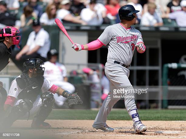 Oswaldo Arcia of the Minnesota Twins hits a single in the fourth inning against the Chicago White Sox at US Cellular Field on May 08 2016 in Chicago...
