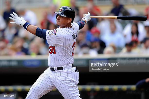 Oswaldo Arcia of the Minnesota Twins hits a solo home run against the Oakland Athletics during the seventh inning of the game on September 12 2013 at...