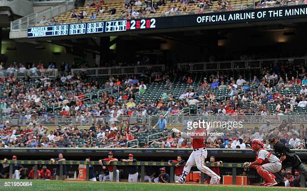 Oswaldo Arcia of the Minnesota Twins hits a walkoff single as Carlos Perez of the Los Angeles Angels of Anaheim catches during the twelfth inning of...