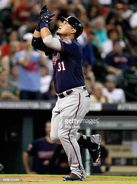 Oswaldo Arcia of the Minnesota Twins homers in the second inning against the Houston Astros at Minute Maid Park on August 12 2014 in Houston Texas
