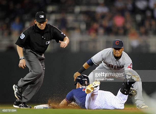 Oswaldo Arcia of the Minnesota Twins is out at second base as Jose Ramirez of the Cleveland Indians fields the ball during the fifth inning of the...