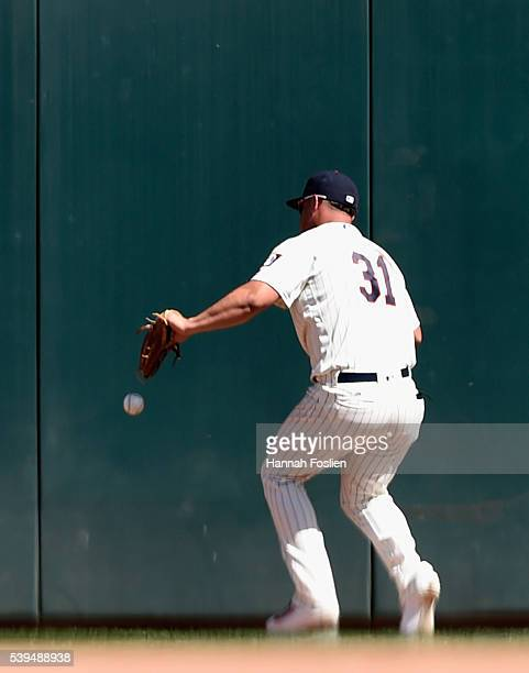Oswaldo Arcia of the Minnesota Twins is unable to hold onto a ball hit by Dustin Pedroia of the Boston Red Sox during the eighth inning of the game...